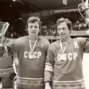 """This photo provided by courtesy of Sony Pictures Classics shows Viacheslav """"Slava"""" Fetisov, left, and Valeri Vasiliev raising trophies won by the Red Army team. The new documentary film, """"Red Army,"""" directed by Gabe Polsky, tells the story of the Soviet Union's relationship with its famed national hockey team through the eyes of Fetisov, the Hall of Fame defenseman who later won two Stanley Cup titles with the Detroit Red Wings. The documentary opens in wider U.S. release on Friday, March 6, 2015. (AP Photo/Sony Pictures Classics)."""