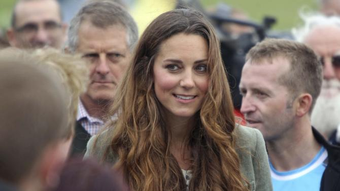 Britain's Catherine, Duchess of Cambridge visits the Breakwater country park, to start the Ring O Fire ultra marathon, in Anglesey, north Wales