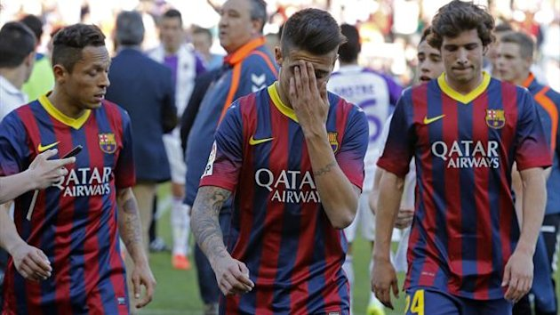 Barcelona's Brazilian defender Adriano, Barcelona's forward Cristian Tello and Barcelona's midfielder Sergi Roberto react at the end of the Spanish league football match Valladolid vs FC Barcelona