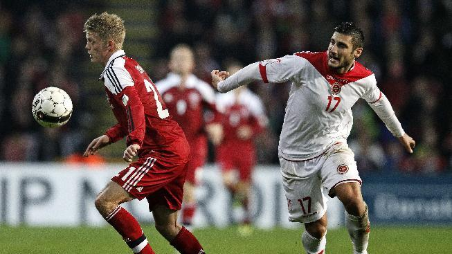 Denmark's Kasper Kusk, left, and Malta's Ryan Fenech during their group B World Cup qualifying soccer match in Parken, Copenhagen, Tuesday Oct. 15, 2013