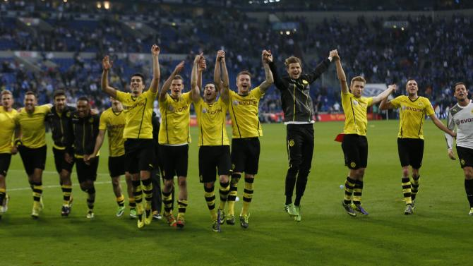 Borussia Dortmund's players celebrate their team's 3-1 victory over Schalke 04 following their German first division Bundesliga soccer match at the Schalke Arena in Gelsenkirchen
