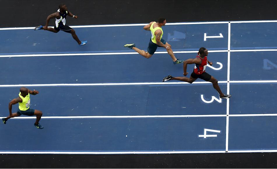 Jamaican Olympic gold medallist Bolt runs against Moreira of Brazil, Bailey of the U.S. and Martina of the Netherlands in the