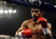 Manny Pacquiao, pictured here in November 2011, says the pieces were falling into place for a world title fight with Floyd Mayweather until the American boxer tried to low-ball him on the split of the pay-per-view revenue