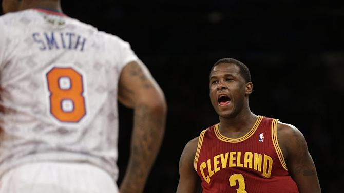 Cleveland Cavaliers' Dion Waiters reacts after making a three-point basket during the second half of the NBA basketball game against the New York Knicks at Madison Square Garden, Sunday, March 23, 2014, in New York. The Cavaliers defeated the Knicks 106 to 100