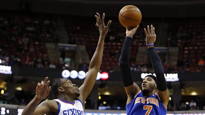 New York Knicks' Carmelo Anthony (7) goes up for a shot against Philadelphia 76ers' Jarvis Varnado (40) during the first half of an NBA basketball game, Friday, March 21, 2014, in Philadelphia