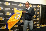 Dwight Howard shows his new jersey after being introduced to the media as the newest member of the Los Angeles Lakers in El Segundo, California, in August 2012. Newcomers Howard and Steve Nash joined the Los Angeles Lakers for Monday's first day of training camp as Kobe Bryant looks for a sixth career NBA title and Pau Gasol bids for his third