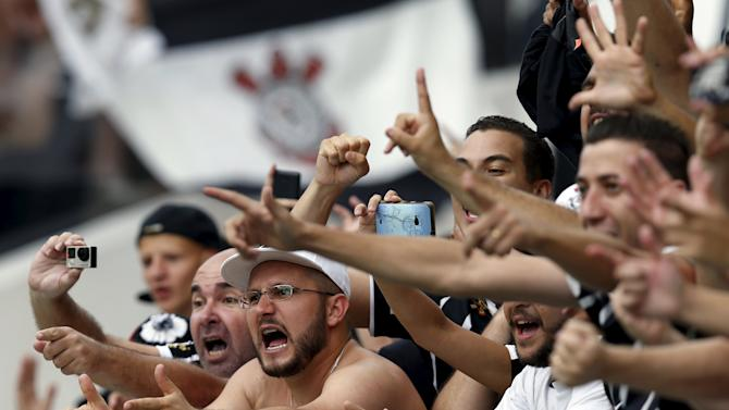 Fans of the Corinthians soccer team cheer during their Brazil Serie A championship soccer match against Sao Paulo, in Sao Paulo, Brazil