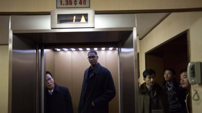 Former NBA basketball star Charles D. Smith enters an elevator at a hotel in Pyongyang, North Korea on Monday, Jan. 6, 2014. Dennis Rodman arrived in North Korea on Monday with a team of fellow former NBA players, including Smith, for an exhibition game on leader Kim Jong Un's birthday, after saying he wants to show that North Korea isn't so bad. (AP Photo/David Guttenfelder)