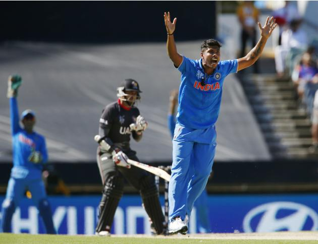 UAE's batsman Krishna Karate looks on as India's bowler Umesh Yadav makes an unsuccessful appeal for his dismissal during their Cricket World Cup match in Perth