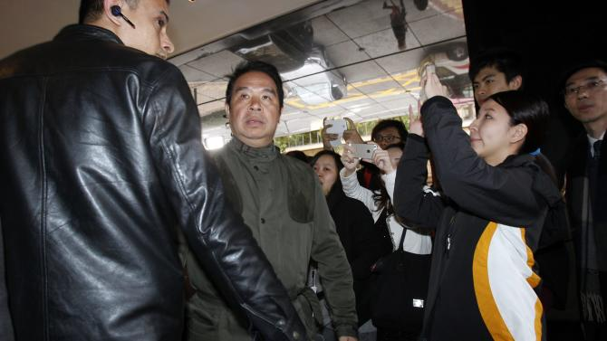 Bodyguard stands beside Birmingham City owner Carson Yeung at hotel in Hong Kong