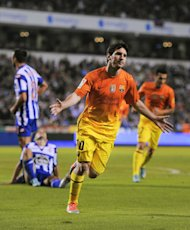 LA CORUNA, SPAIN - OCTOBER 20: Lionel Messi of FC Barcelona celebrates after scoring his team's fifth goal during the La Liga match between Deportivo La Coruna and FC Barcelona at Riazor Stadium on October 20, 2012 in La Coruna, Spain. FC Barcelona won 4-5. (Photo by David Ramos/Getty Images)