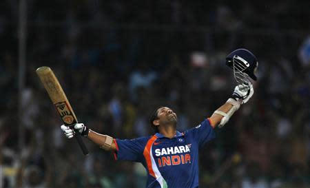 File photo of India's Tendulkar celebrating his double century against South Africa in Gwalior