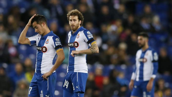 Espanyol's players Lucas Vazquez and Jose Canas react after Athletic Bilbao scored a goal during their semi-final second leg Spanish King's Cup trophy match, near Barcelona
