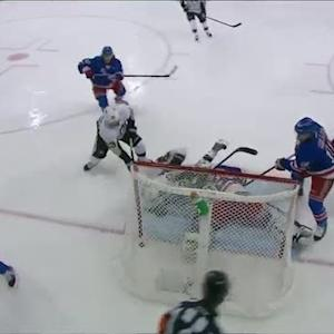 Spaling redirects the puck behind Lundqvist