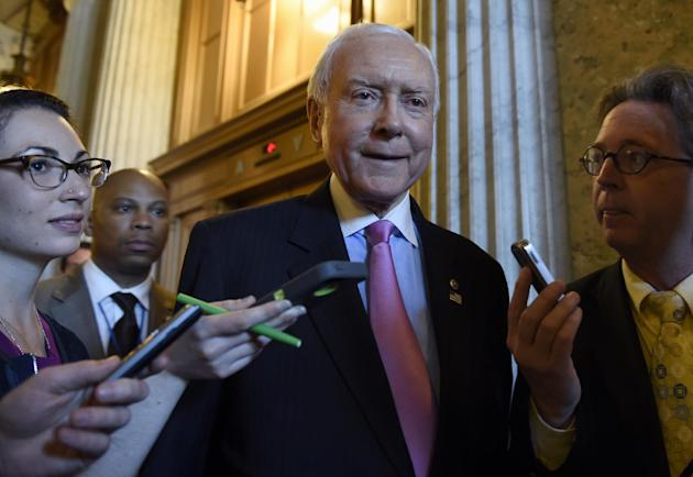 Sen. Orrin Hatch, R-Utah. is surrounded by reporters as he walks to a luncheon with other Senate Republicans on Capitol Hill in Washington, Friday, May 22, 2015. Supporters of President Barack Obama&#
