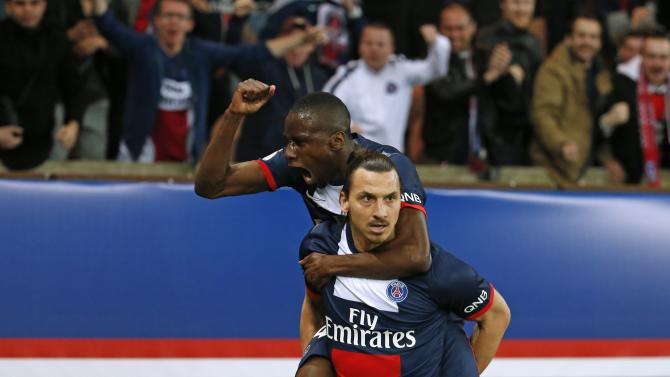 Paris St Germain's Zlatan Ibrahimovic celebrates with team mate Blaise Matuiti after scoring against St Etienne during their French Ligue 1 soccer match at the Parc des Princes Stadium in Paris