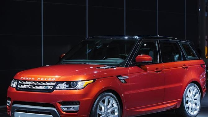 A Range Rover Sport from Land Rover is displayed on stage after an unveiling at the New York International Auto Show in New York