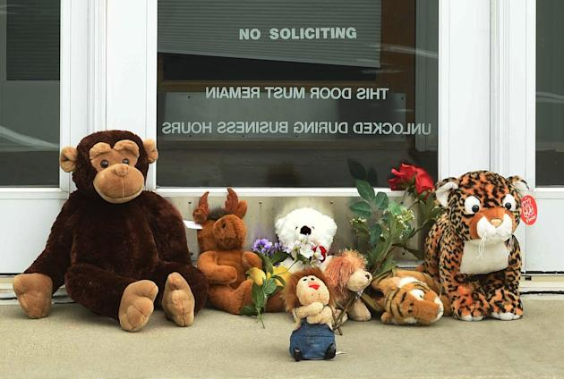 Stuffed animals adorn the doorstep of Dr. Walter Palmer's River Bluff Dental office in Bloomington, Minn., Tuesday, July 28, 2015. Palmer, accused of illegally killing a protected lion in Zimbabwe