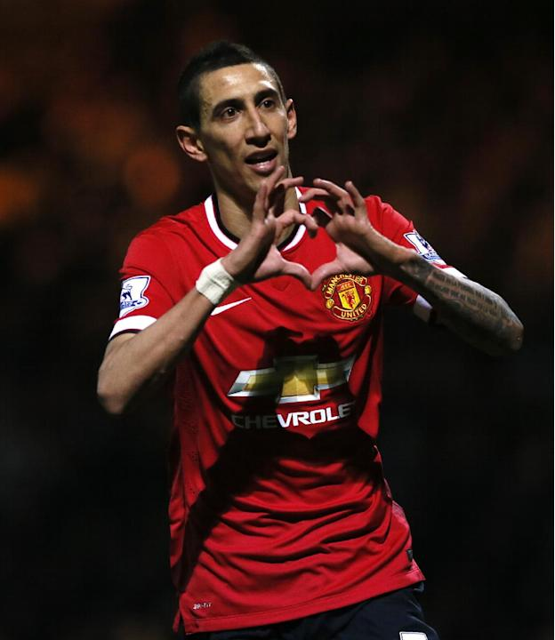 Manchester United's Angel Di Maria celebrates after scoring his sides second goal of the game during their English FA Cup third round soccer match between Yeovil Town and Manchester United at Hu