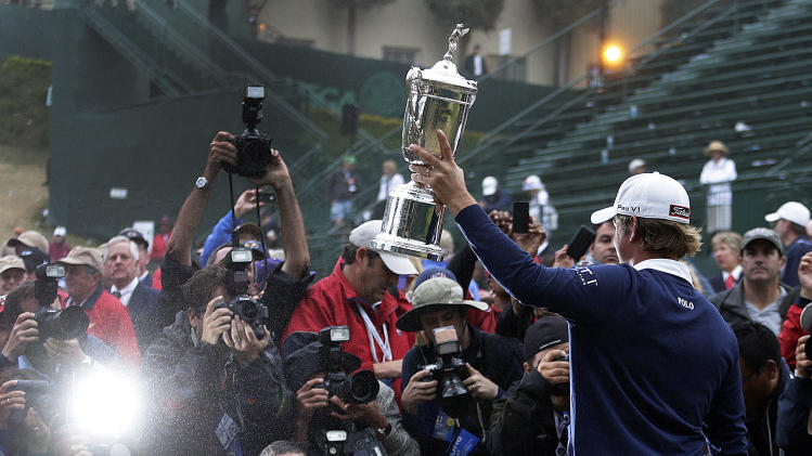 Webb Simpson posses with the championship trophy after the U.S. Open Championship golf tournament Sunday, June 17, 2012, at The Olympic Club in San Francisco. (AP Photo/Eric Gay)