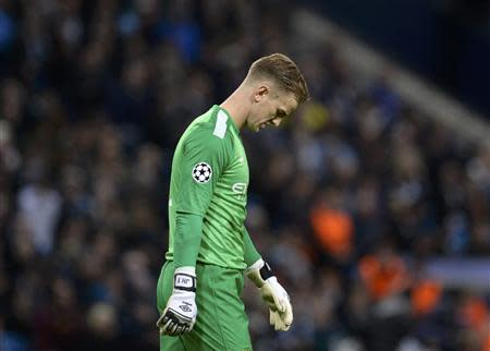 Manchester City's goalkeeper Joe Hart reacts after Barcelona's second goal during their Champions League round of 16 first leg soccer match at the Etihad Stadium in Manchester