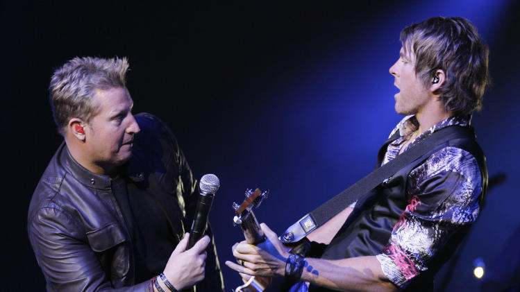 Gary LeVox, left, and Joe Don Doorney of Rascal Flatts perform during the All for the Hall concert on Tuesday, April 10, 2012, in Nashville, Tenn. The concert is a benefit for the Country Music Hall of Fame and Museum. (AP Photo/Mark Humphrey)
