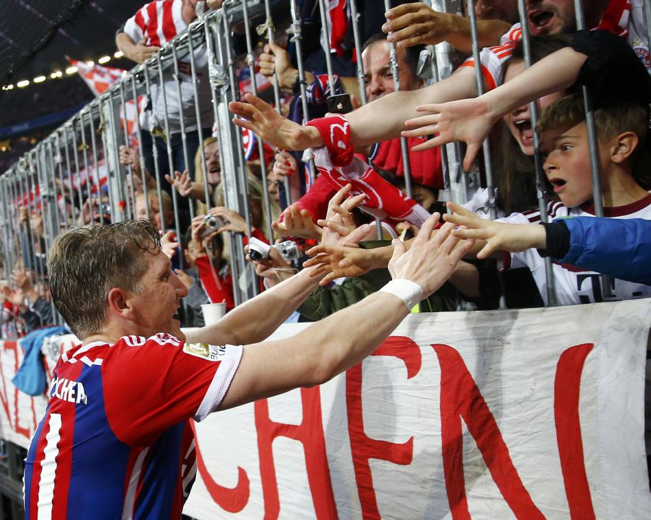 Bayern Munich's Schweinsteiger celebrates with fans after scoring a goal against Hertha Berlin during Bundesliga first division soccer match in Munich