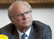 "Sweden's King Carl XVI Gustaf gives an interview at the Royal Castle in Stockholm in May 2011. Counterfeit Swedish coins bearing a reference to ""whore king"" Carl XVI Gustaf have been found in circulation, media reports said Thursday"
