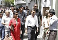 "Mohamed Nasheed (centre) prepares to enter the Indian Embassy in Male on Wednesday. Indian diplomats are ""interfering"" in the country's affairs by sheltering the former Maldivian president in India's embassy in Male, a senior Maldivian government official said Saturday"