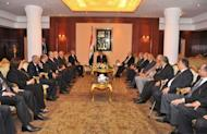 In this handout picture made available by the Egyptian presidency, Egyptian President Mohamed Morsi (C top) meets members of the constitutional high court prior to his swearing-in ceremony at the Constitutional Court in Cairo