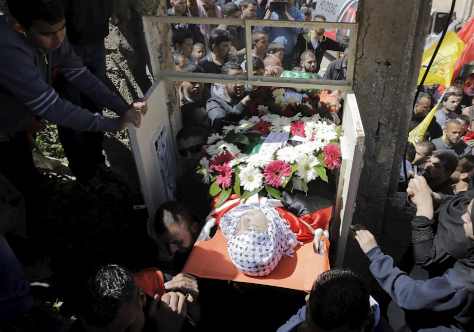 Mourners carry the body of Safi during his funeral in Jalazoun refugee camp near the West Bank city of Ramallah