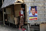 File photo shows a campaign poster for Andal Ampatuan Snr in Maguindanao southern Philippines. The patriarch of the clan is blamed for the Philippines' worst political killing in history. Their power may have been diminished and their leaders in jail, but the Ampatuan clan continues to cast a menacing shadow over its fiefdom