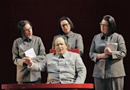 In this June 5, 2012 handout photo provided by the San Francisco Opera, Simon O'Neill, as Mao Tse-tung, foreground, is shown with his three secretaries—Ginger Costa Jackson, from left, Buffy Baggott and Nicole Birkland, during a scene from the final dress rehearsal of Nixon in China. The production, increasingly recognized as a modern masterpiece, is finally getting the recognition it deserves on the home ground of composer John Adams, in a sparkling production that highlights the San Francisco Opera's summer season. (AP Photo/San Francisco Opera, Cory Weaver, handout)