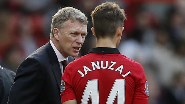 Manchester United manager David Moyes talks to Adnan Januzaj (Reuters)
