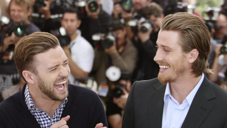 Actors Justin Timberlake and Garrett Hedlund during a photo call for the film Inside Llewyn Davis at the 66th international film festival, in Cannes, southern France, Sunday, May 19, 2013. (Photo by Joel Ryan/Invision/AP)