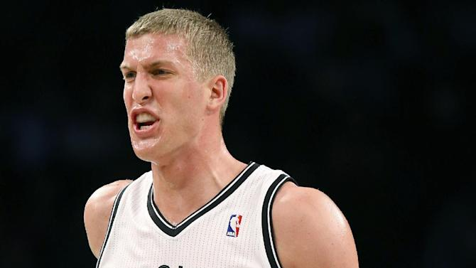 Brooklyn Nets power forward Mason Plumlee (1) reacts after scoring during the second quarter of a NBA basketball game against the Indiana Pacers, Saturday, Nov. 9, 2013, at the Barclays Center in New York. The Indiana Pacers defeated the Brooklyn Nets, 96-91