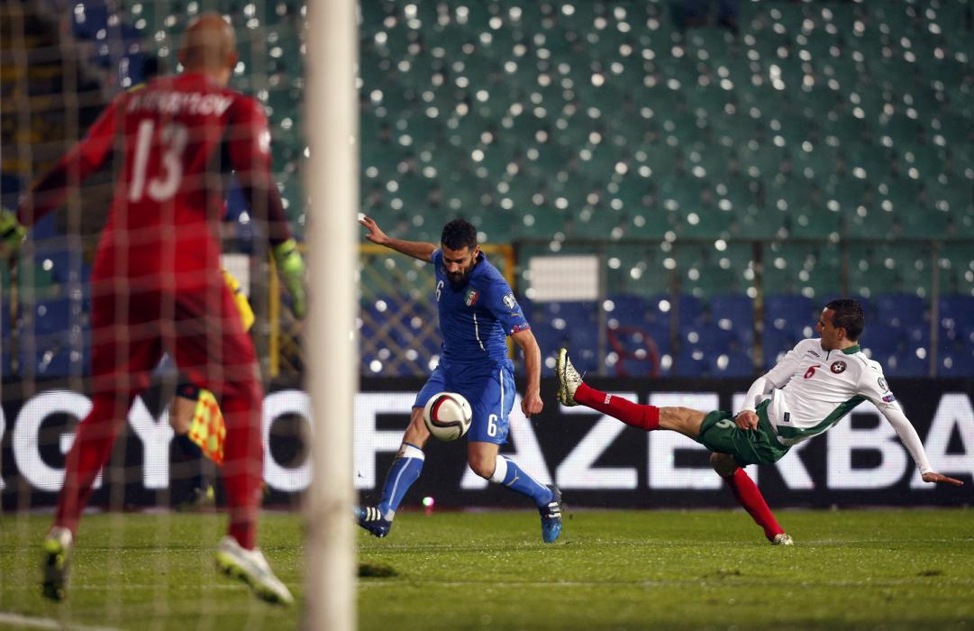 Candreva of Italy challenges Minev and goalkeeper Mihaylov of Bulgaria during their Euro 2016 qualifying soccer match in Sofia