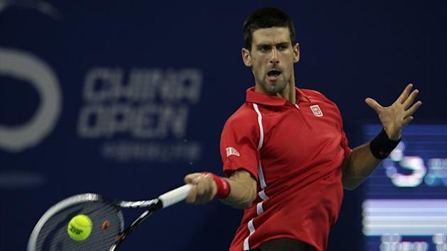 Serbia's Novak Djokovic hits a shot during his match against Germany's Michael Berrer at the China Open (Reuters)