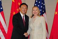 "US Secretary of State Hillary Clinton and Chinese Foreign Minister Yang Jiechi meet in Honolulu, Hawaii, during a bilateral meeting on the sidelines of the Asia-Pacific Economic Cooperation (APEC) Summit. Clinton said the US welcomed a ""thriving China"" but pressed the Asian nation on human rights and its economic policies"