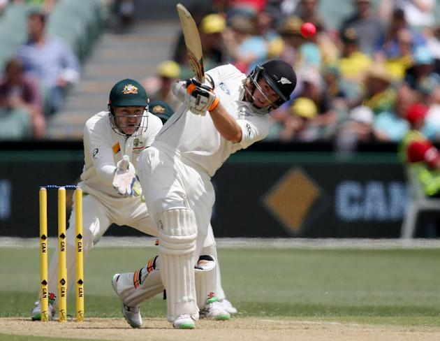 New Zealand's Tom Latham plays a shot as Australia's Peter Nevill, left, watches during their cricket test in Adelaide, Friday, Nov. 27, 2015. This match is the sport's first ever day-nigh