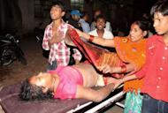 A victim of the stampede is rushed to hospital after a bamboo bridge collapsed during Chhat Puja on the banks of the Ganges River in Patna on November 19, 2012. Patna police superintendent Jayant Kant said that a total of 18 people were confirmed dead -- 10 women and eight children -- but that the toll was likely to rise as several other devotees were reported missing at the site