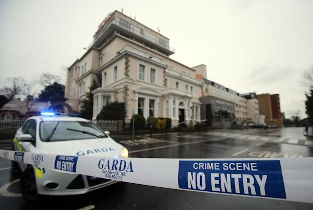 A police (Garda) cordon outside the Regency Hotel in Dublin, Ireland, after one man died and two others were injured following a shooting incident at the hotel, Friday Feb. 5, 2016.  According to witn