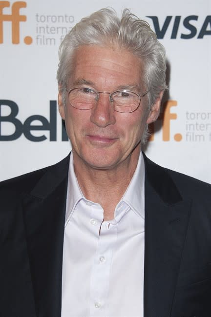 "FILE - In this Sept. 7, 2014 file photo, actor Richard Gere seen at the ""Time Out Of Mind"" premiere at the Elgin Theatre during the 2014 Toronto International Film Festival in Toronto. The 1"