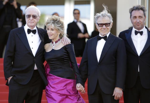 From left, actors Michael Caine, Jane Fonda, Harvey Keitel and director Paolo Sorrentino pose for photographers for the screening of the film Youth at the 68th international film festival, Cannes, sou