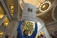 Marcel Gaztambide holds a sign to support same-sex marriage during a rally at the state capitol in Salt Lake City, Utah January 10, 2014. REUTERS/Sallie Dean Shatz