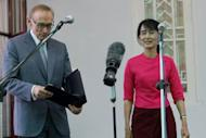 Myanmar opposition leader Aung San Suu Kyi and Australian Foreign Minister Bob Carr address the press after a meeting at Suu Kyi's house in Yangon on June 6. Australia will lift remaining sanctions against Myanmar and more than double its foreign aid to encourage democratic reforms, the country's foreign minister said after talks with the government