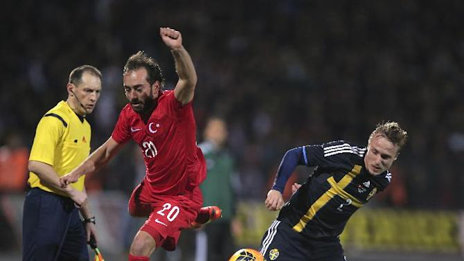 Turkey's Olcan Adin, left, vies for the ball with Sweden's Pierre Bengtsson during their International Friendly soccer match at 19 Mayis Stadium in Ankara, Turkey, Wednesday, March 5, 2014. (AP Photo)