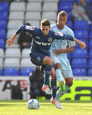 Matt Derbyshire, front, has extended his loan with Oldham