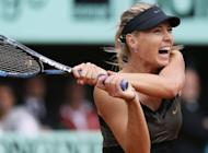 Russia's Maria Sharapova hits a return to Italy's Sara Errani during their final French Open match. Sharapova won 6-3, 6-2 to complete the career Grand Slam