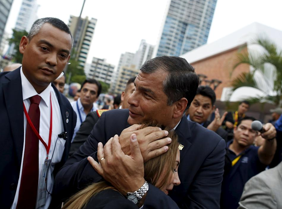 Ecuador's President Rafael Correa hugs a woman while walking to the Atlapa Convention Center where the second plenary session of the VII Summit of the Americas is taking place in Panama